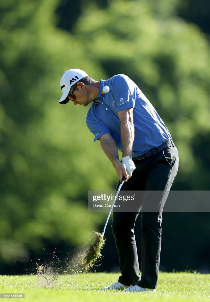 Justin Rose of England plays his third shot on the par 5, 17th hole during the second round of the 2017 BMW PGA Championship on the West Course at Wentworth on May 26, 2017 in Virginia Water, England.