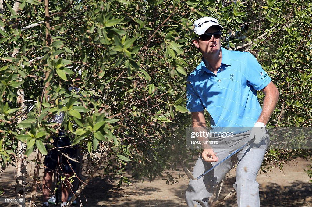<a gi-track='captionPersonalityLinkClicked' href=/galleries/search?phrase=Justin+Rose&family=editorial&specificpeople=171559 ng-click='$event.stopPropagation()'>Justin Rose</a> of England plays his third shot on the par five 10th hole during the third round of the Abu Dhabi HSBC Golf Championship at the Abu Dhabi Golf Club on January 19, 2013 in Abu Dhabi, United Arab Emirates.