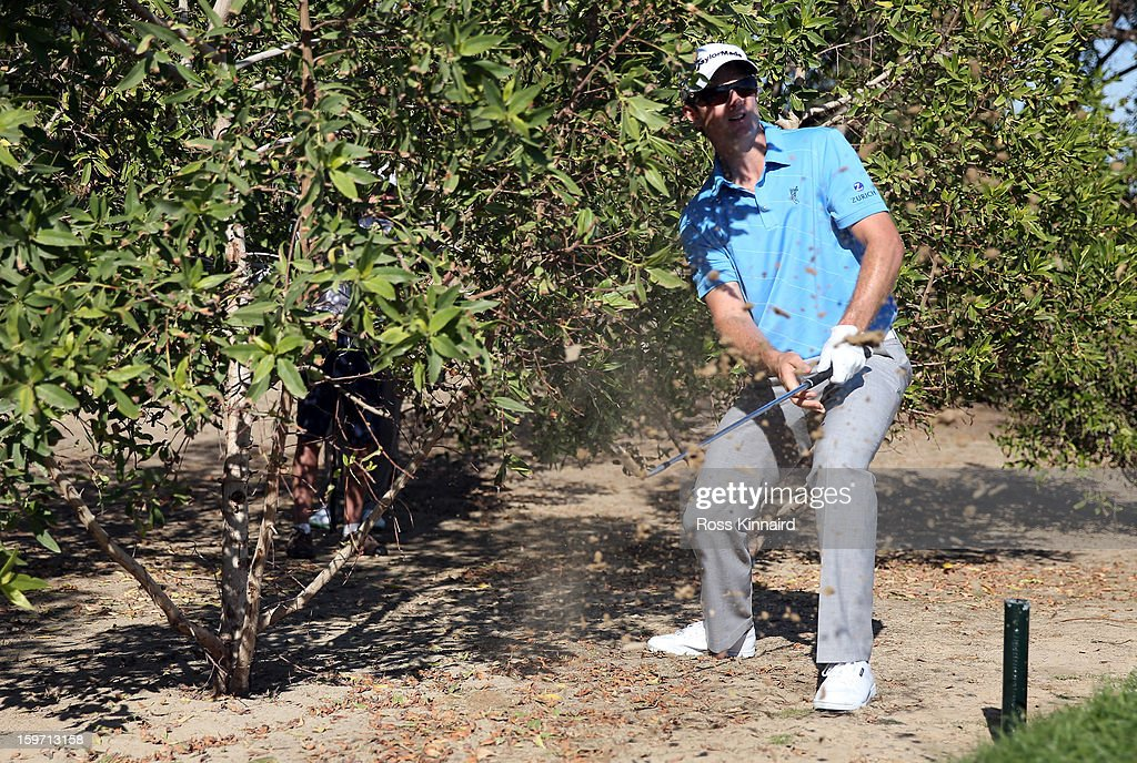 Justin Rose of England plays his third shot on the par five 10th hole during the third round of the Abu Dhabi HSBC Golf Championship at the Abu Dhabi Golf Club on January 19, 2013 in Abu Dhabi, United Arab Emirates.