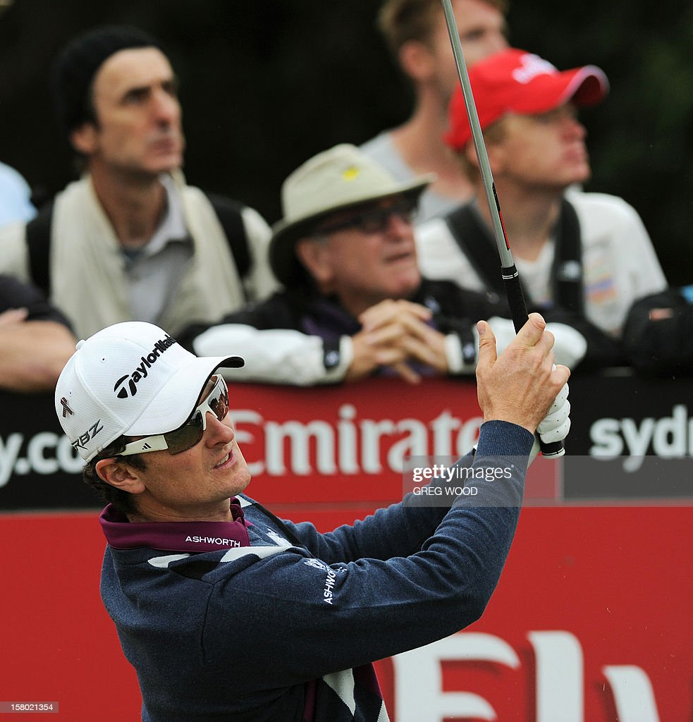 Justin Rose of England plays off the ninth tee during the final round of the Australian Open golf at The Lakes course in Sydney on December 9, 2012. IMAGE STRICTLY RESTRICTED TO EDITORIAL USE - STRICTLY NO COMMERCIAL USE AFP PHOTO / Greg WOOD