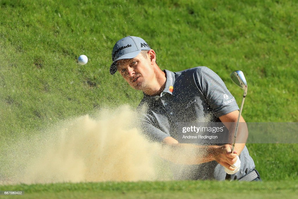 Justin Rose of England plays out of a bunker on the 3rd during the BMW PGA Championship Pro-AM at Wentworth on May 24, 2017 in Virginia Water, England.