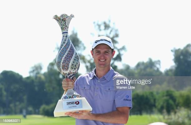 Justin Rose of England poses with the trophy after beating fellow countryman Lee Westwood to win the Turkish Airlines World Golf Final final Day at...