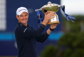 Justin Rose of England poses with the trophy after winning the 2014 Aberdeen Asset Management Scottish Open at Royal Aberdeen Golf Club on July 13...