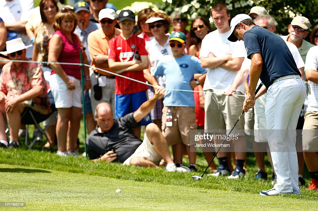 <a gi-track='captionPersonalityLinkClicked' href=/galleries/search?phrase=Justin+Rose&family=editorial&specificpeople=171559 ng-click='$event.stopPropagation()'>Justin Rose</a> of England putts out of the rough at the 5th hole during the third round of the 2013 Travelers Championship at TPC River Highlands on June 22, 2012 in Cromwell, Connecticut.