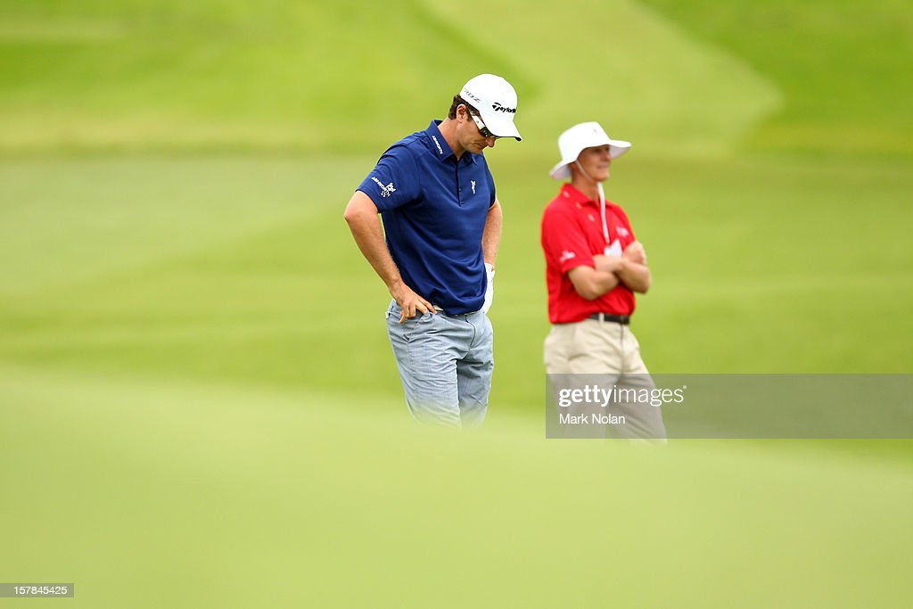 <a gi-track='captionPersonalityLinkClicked' href=/galleries/search?phrase=Justin+Rose&family=editorial&specificpeople=171559 ng-click='$event.stopPropagation()'>Justin Rose</a> of England reacts after a bad shot during round two of the 2012 Australian Open at The Lakes Golf Club on December 7, 2012 in Sydney, Australia.