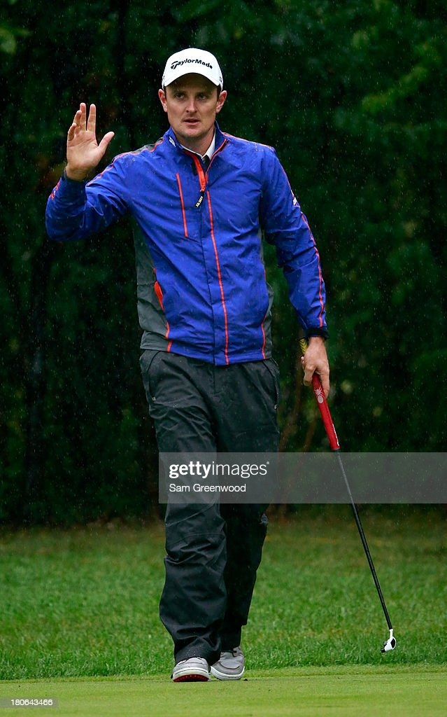 <a gi-track='captionPersonalityLinkClicked' href=/galleries/search?phrase=Justin+Rose&family=editorial&specificpeople=171559 ng-click='$event.stopPropagation()'>Justin Rose</a> of England reacts after a putt on the first green during the Final Round of the BMW Championship at Conway Farms Golf Club on September 15, 2013 in Lake Forest, Illinois.