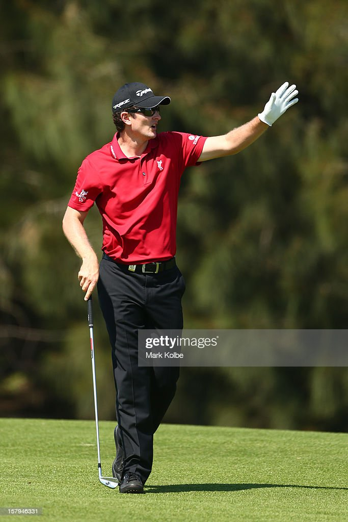 Justin Rose of England reacts after playing a fairway shot during round three of the 2012 Australian Open at The Lakes Golf Club on December 8, 2012 in Sydney, Australia.