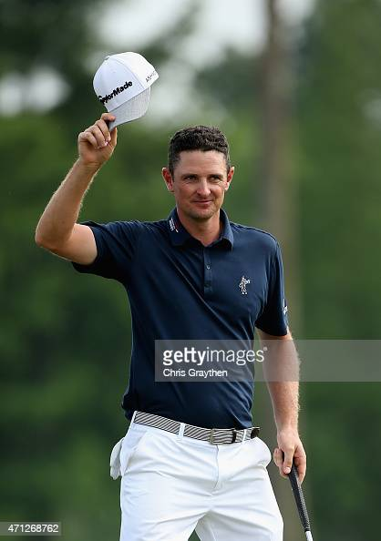 Justin Rose of England reacts after putting in for a birdie to win on the 18th hole during the final round of the Zurich Classic of New Orleans at...