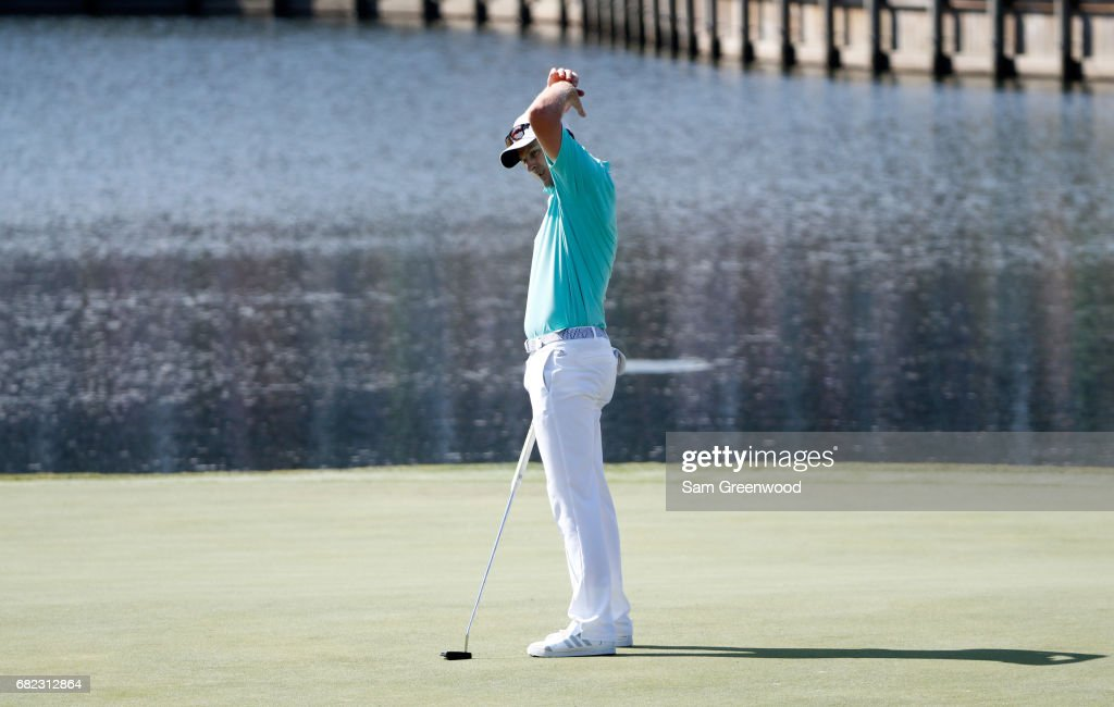 Justin Rose of England reacts on the 17th green during the second round of THE PLAYERS Championship at the Stadium course at TPC Sawgrass on May 12, 2017 in Ponte Vedra Beach, Florida.