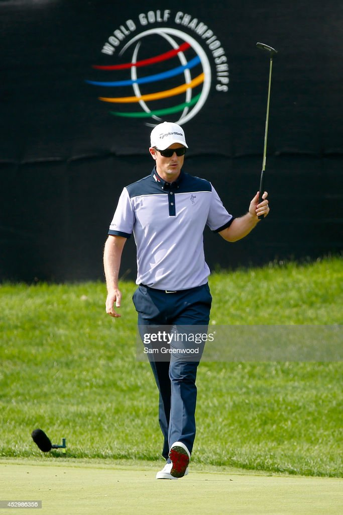 Justin Rose of England reacts to a birdie putt on the 16th green during the first round of the World Golf Championships-Bridgestone Invitational at Firestone Country Club South Course on July 31, 2014 in Akron, Ohio.