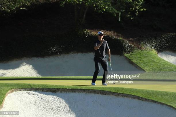Justin Rose of England reacts to a missed putt on the 12th green during the final round of the 2017 Masters Tournament at Augusta National Golf Club...