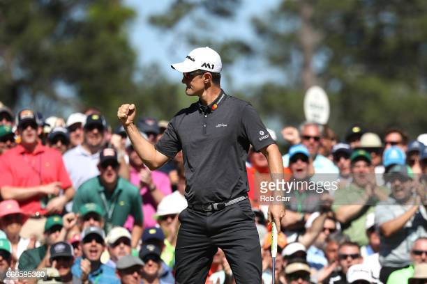 Justin Rose of England reacts to a putt for birdie on the sixth hole during the final round of the 2017 Masters Tournament at Augusta National Golf...
