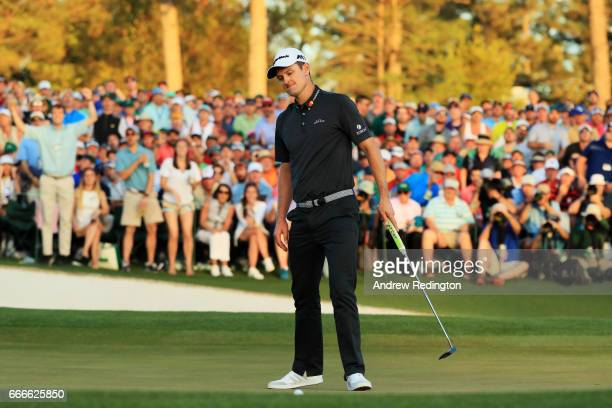 Justin Rose of England reacts to his missed putt on the first playoff hole during the final round of the 2017 Masters Tournament at Augusta National...