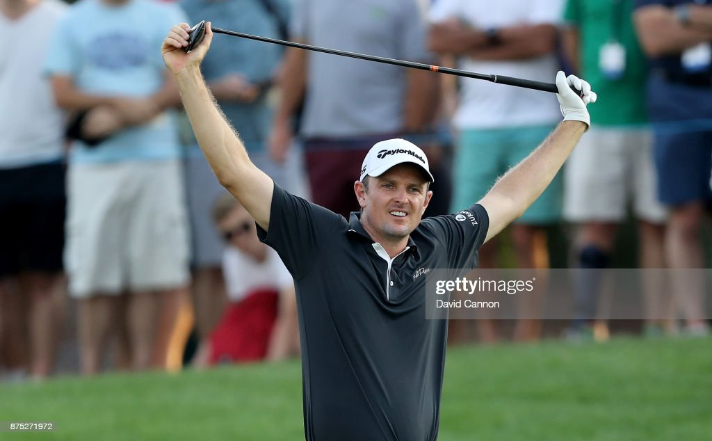 Justin Rose of England reacts to his poor second shot on the 18th hole during the second round of the DP World Tour Championship on the Earth Course at Jumeirah Golf Estates on November 17, 2017 in Dubai, United Arab Emirates.