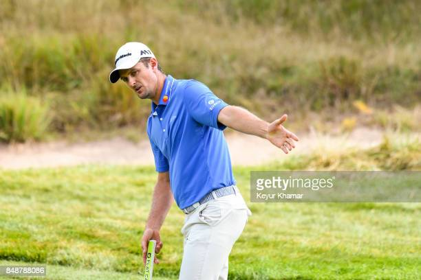 Justin Rose of England reacts to his putt on the 14th hole green during the final round of the BMW Championship at Conway Farms Golf Club on...