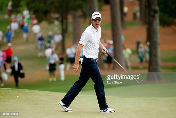 Justin Rose of England reacts to saving par on the seventh hole during the final round of the 2015 Masters Tournament at Augusta National Golf Club...