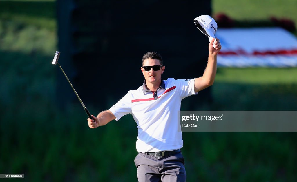 Justin Rose of England reacts to winning a playoff on the 18th green during the final round of the Quicken Loans National at Congressional Country Club on June 29, 2014 in Bethesda, Maryland.