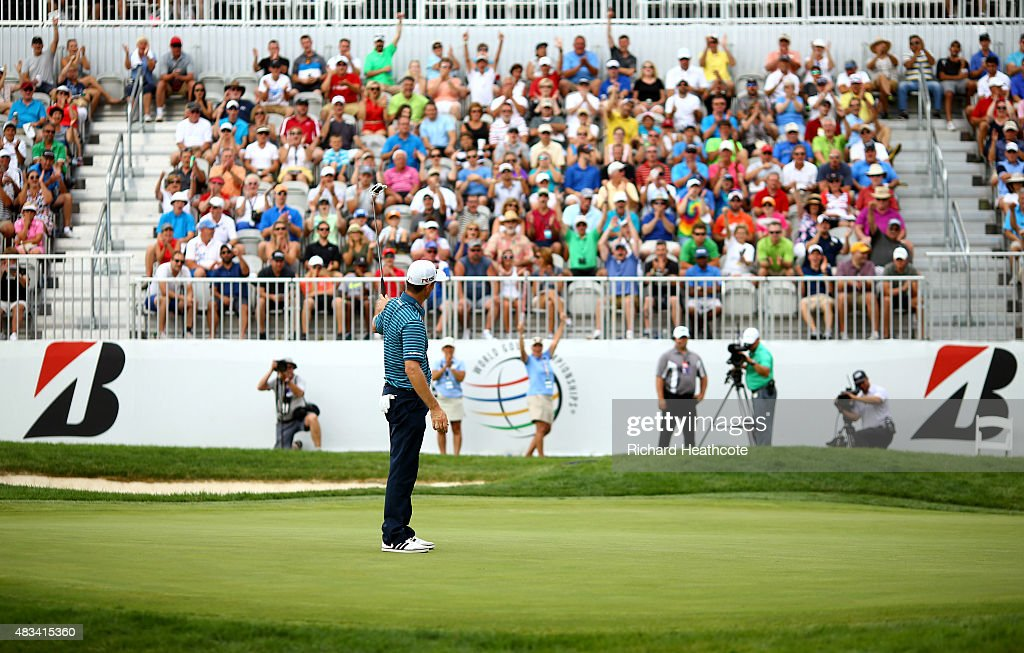 Justin Rose of England reacts with the crowd after putting for birdie on the 18th green during the third round of the World Golf Championships - Bridgestone Invitational at Firestone Country Club South Course on August 8, 2015 in Akron, Ohio.