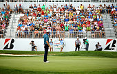Justin Rose of England reacts with the crowd after putting for birdie on the 18th green during the third round of the World Golf Championships...