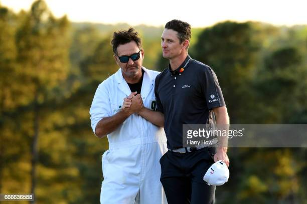 Justin Rose of England shakes hands with caddie Mark Fulcher after finishing second to Sergio Garcia of Spain in a onehole playoff during the final...