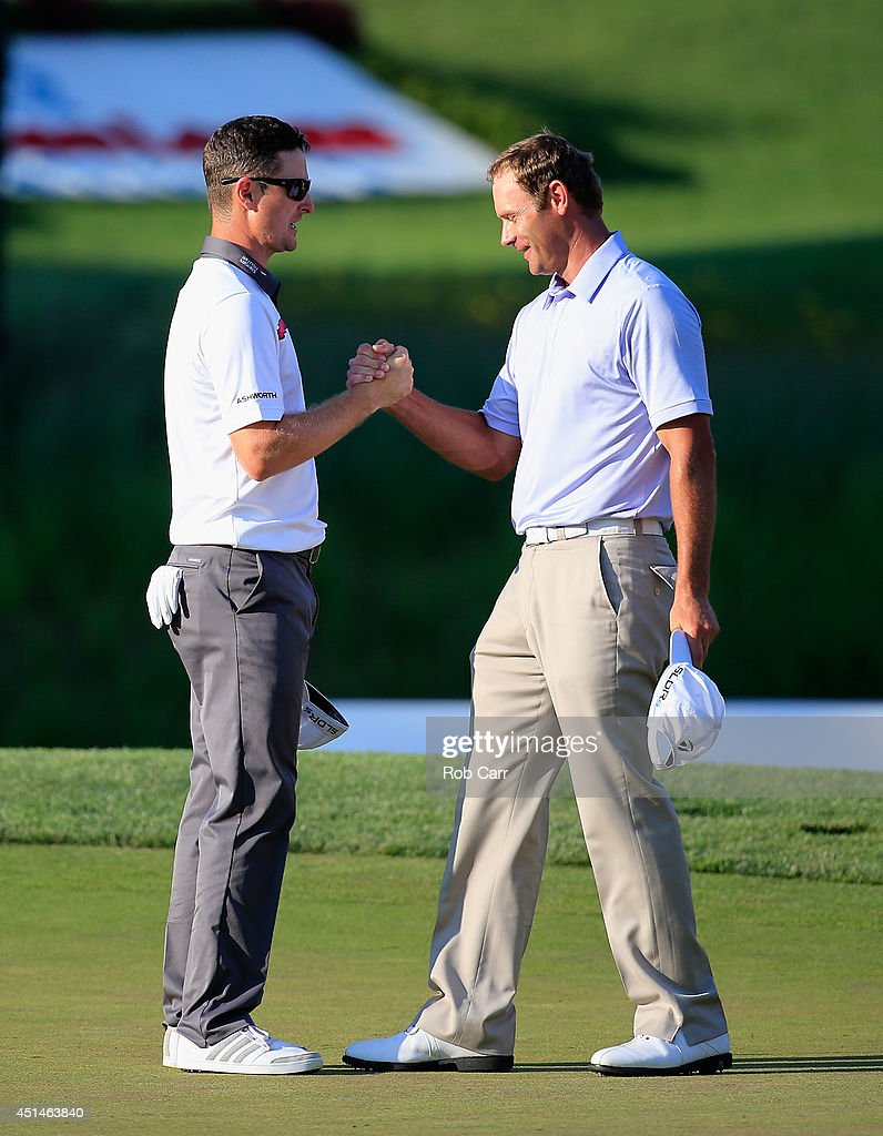 Justin Rose (L) of England shakes hands with Shawn Stefani (R) of the United States after Rose won on the first playoff during the final round of the Quicken Loans National at Congressional Country Club on June 29, 2014 in Bethesda, Maryland.