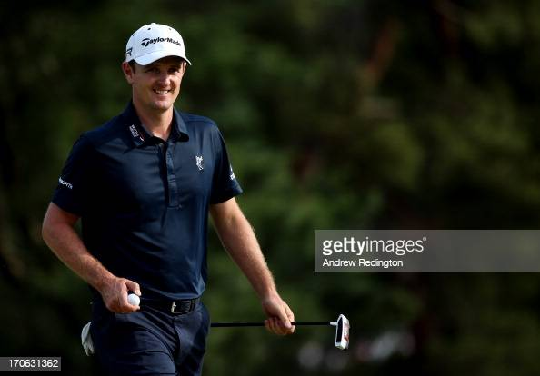 Justin Rose of England smiles after making a putt for birdie on the tenth hole during Round Three of the 113th US Open at Merion Golf Club on June 15...