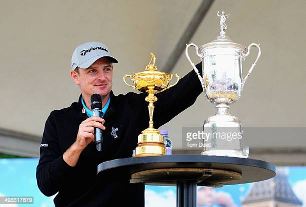 Justin Rose of England speaks to spectators on stage in the tented village with the Ryder Cup and US Open trophies during day two of the BMW PGA...