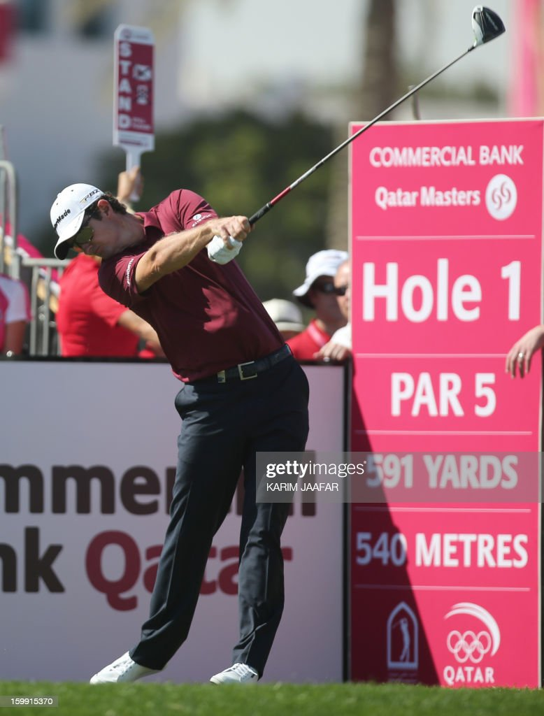 Justin Rose of England strikes the ball during the first round of the Qatar Masters Golf tournament in the Qatari capital Doha, on January 23, 2013.