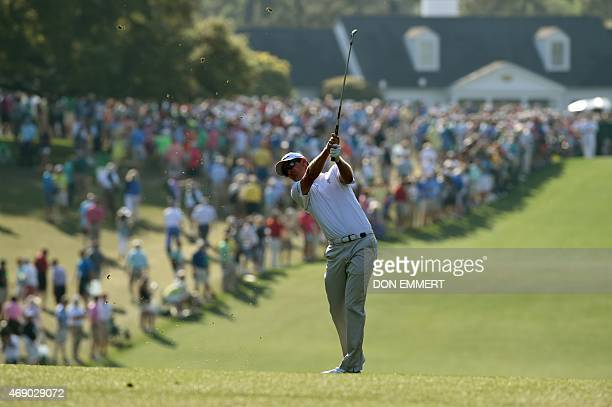 Justin Rose of England takes a shot from the 1st hole fairway during Round 1 of the 79th Masters Golf Tournament at Augusta National Golf Club on...