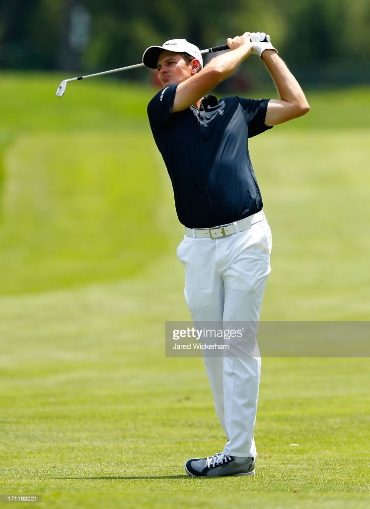 <a gi-track='captionPersonalityLinkClicked' href=/galleries/search?phrase=Justin+Rose&family=editorial&specificpeople=171559 ng-click='$event.stopPropagation()'>Justin Rose</a> of England takes his second shot on the 4th hole during the third round of the 2013 Travelers Championship at TPC River Highlands on June 22, 2012 in Cromwell, Connecticut.