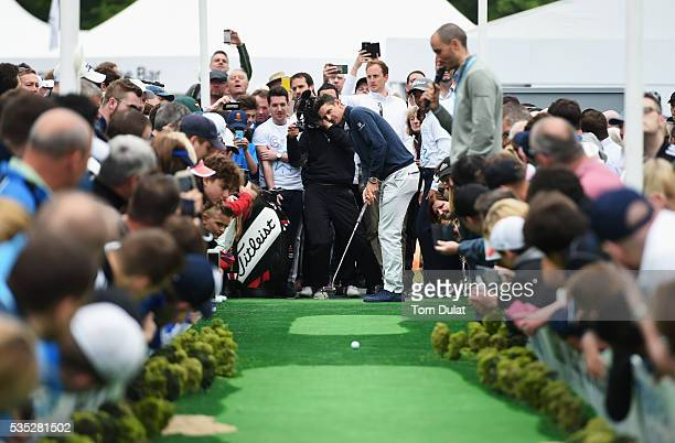 Justin Rose of England takes part in the Totally Mega Putt Challenge initiative in the Championship Village during day four of the BMW PGA...