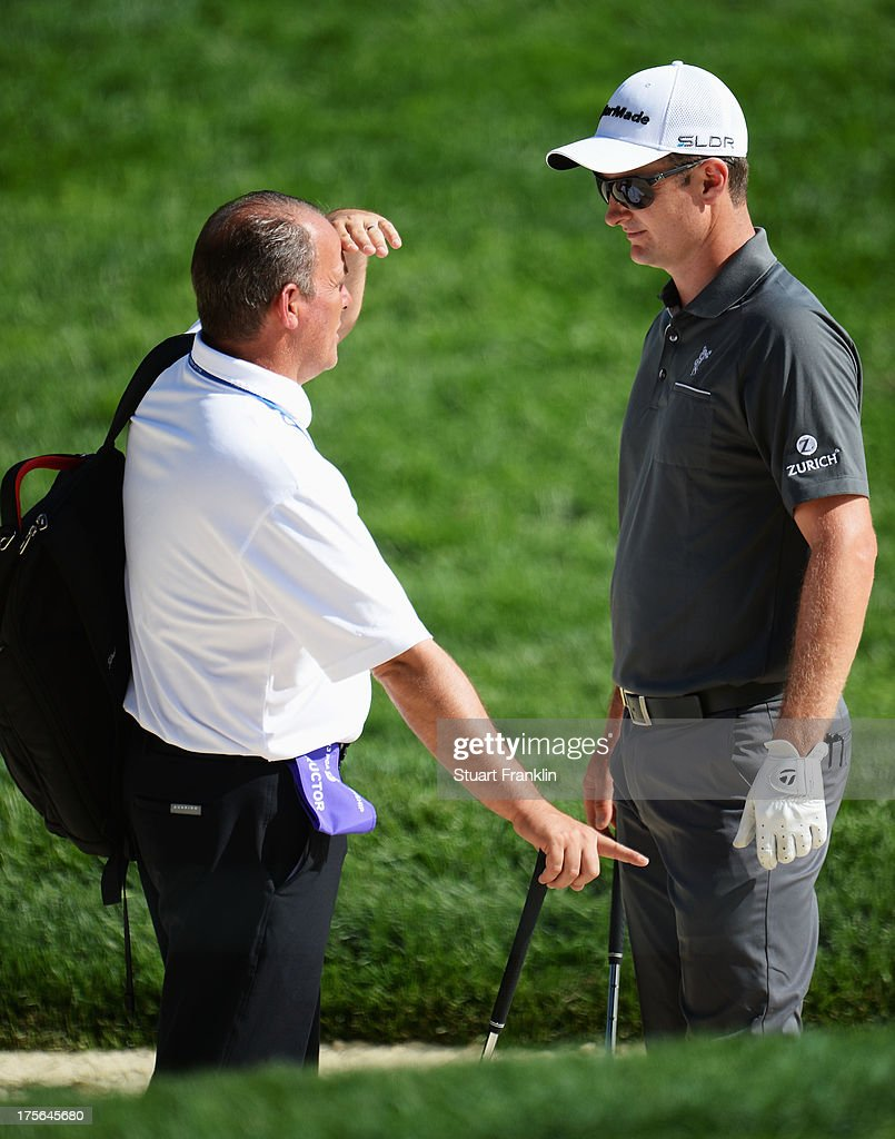 Justin Rose of England talks with an advisor during a practice round prior to the start of the 95th PGA Championship at Oak Hill Country Club on August 5, 2013 in Rochester, New York.
