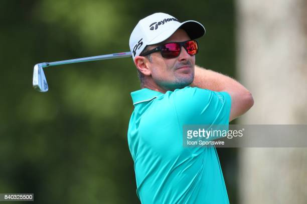 Justin Rose of England tees off at the 2nd hole during the final round of The Northern Trust PGA Golf Tournament on August 27 2017 at Glen Oaks Club...