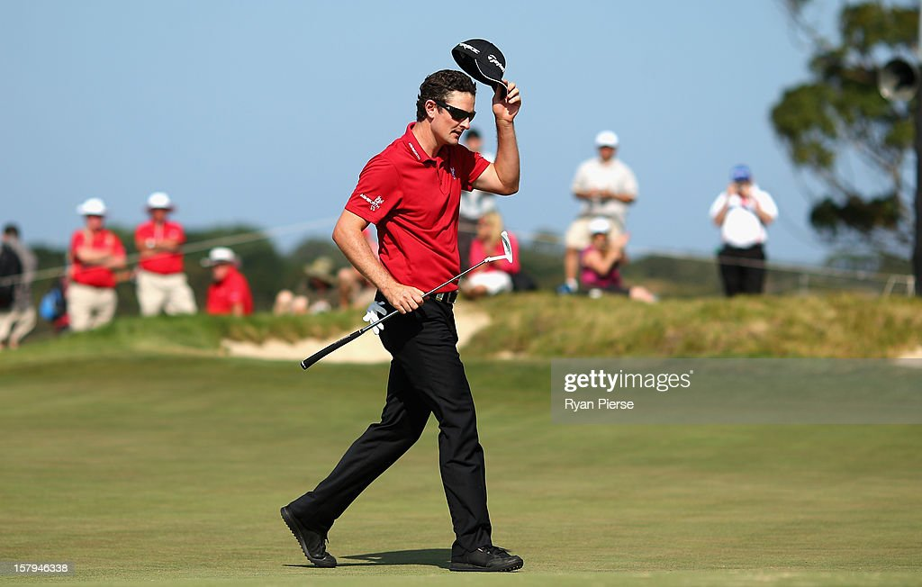 Justin Rose of England thanks the crowd on the 18th Green during round three of the 2012 Australian Open at The Lakes Golf Club on December 8, 2012 in Sydney, Australia.