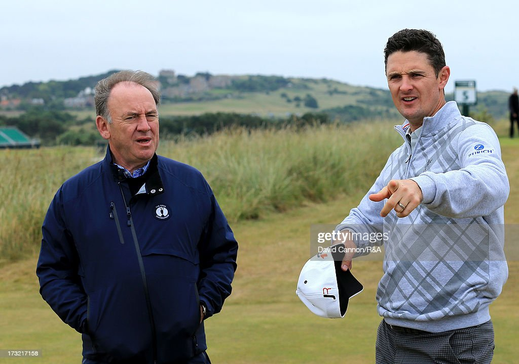 <a gi-track='captionPersonalityLinkClicked' href=/galleries/search?phrase=Justin+Rose&family=editorial&specificpeople=171559 ng-click='$event.stopPropagation()'>Justin Rose</a> of England the 2013 US Open Champion is greeted by <a gi-track='captionPersonalityLinkClicked' href=/galleries/search?phrase=Peter+Dawson&family=editorial&specificpeople=240418 ng-click='$event.stopPropagation()'>Peter Dawson</a> The Chief Executive of the R&A during a practice round as a preview for the 2013 Open Championship at Muirfield on July 10, 2013 in Gullane, Scotland.
