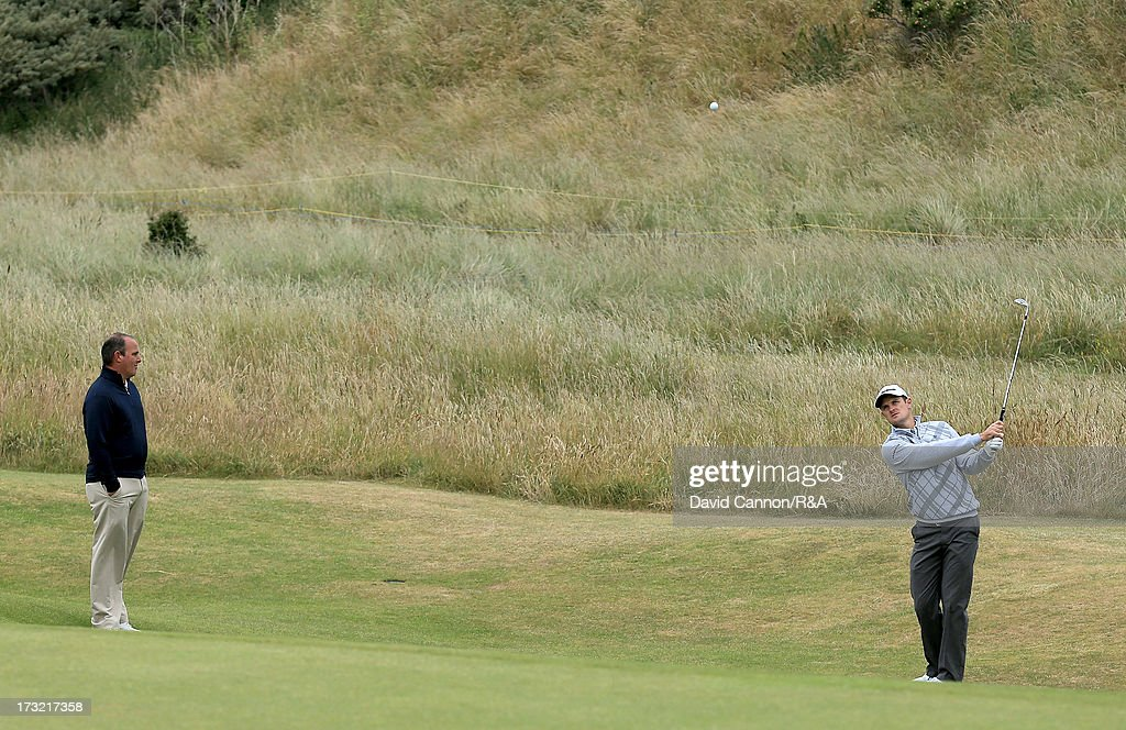 Justin Rose of England the 2013 US Open Champion watched by his short game coach David Orr of the USA during a practice round as a preview for the 2013 Open Championship at Muirfield on July 10, 2013 in Gullane, Scotland.