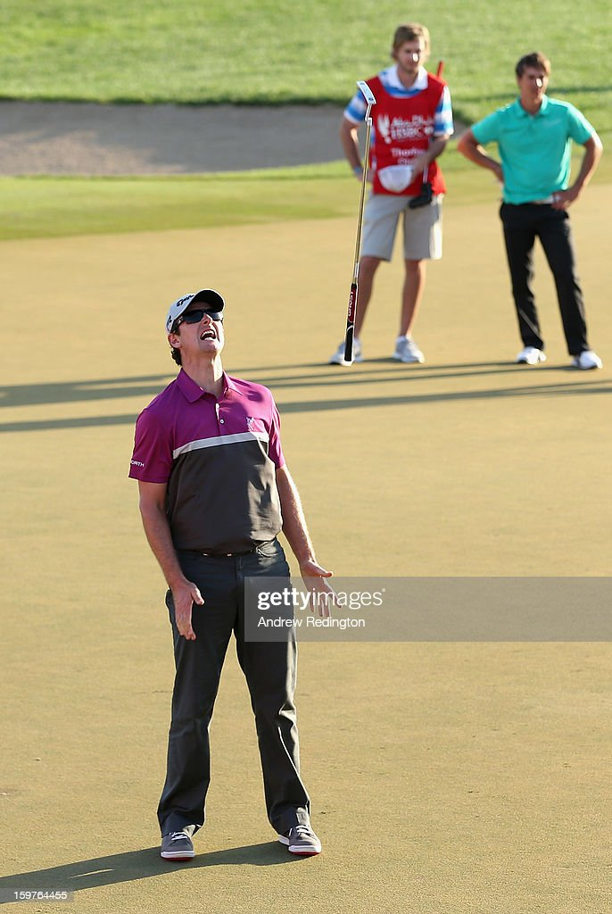 Justin Rose of England throws his putter in the air, after missing a putt to go to a play-off on the 18th hole during the final round of The Abu Dhabi HSBC Golf Championship at Abu Dhabi Golf Club on January 20, 2013 in Abu Dhabi, United Arab Emirates.