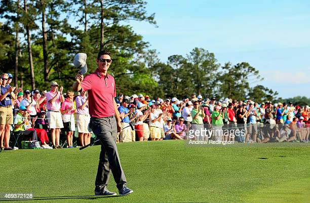 Justin Rose of England tips his cap after a birdie putt on the 18th hole during the third round of the 2015 Masters Tournament at Augusta National...