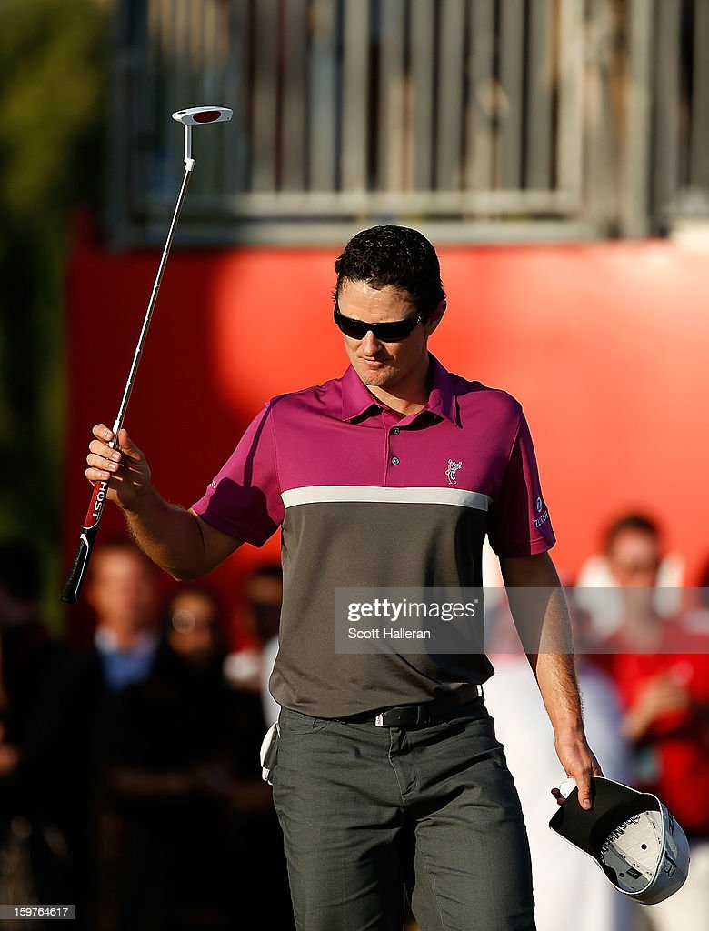 Justin Rose of England walks off the 18th green during the final round of the Abu Dhabi HSBC Golf Championship at Abu Dhabi Golf Club on January 20, 2013 in Abu Dhabi, United Arab Emirates.