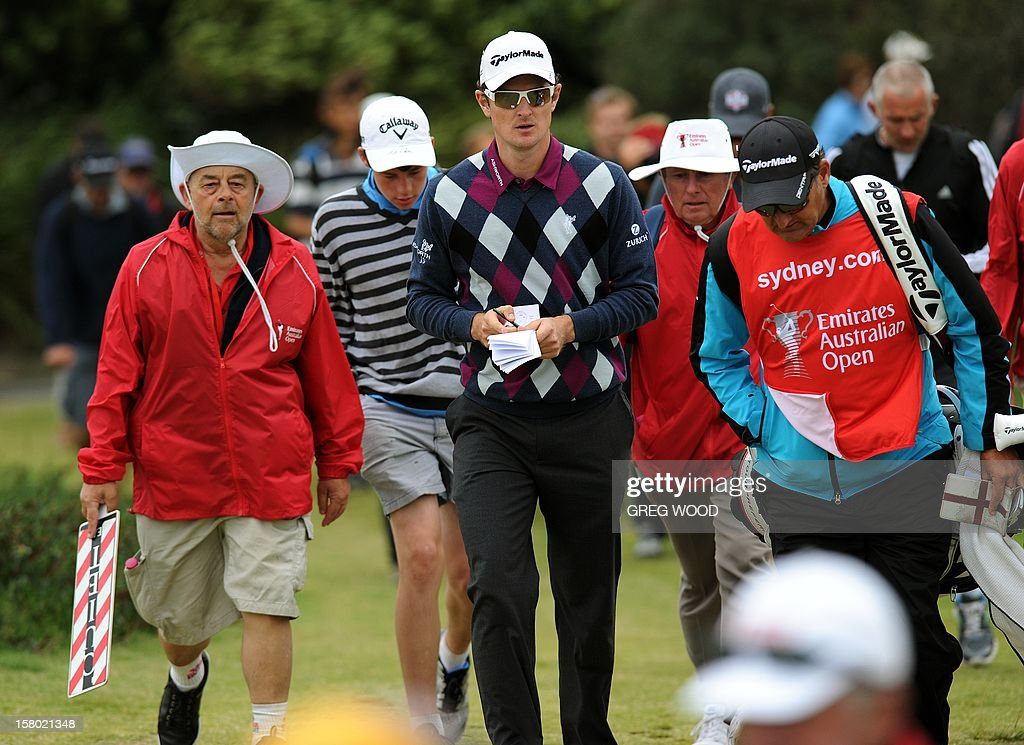 Justin Rose of England (C) walks to the ninth tee during the final round of the Australian Open golf at The Lakes course in Sydney on December 9, 2012. IMAGE STRICTLY RESTRICTED TO EDITORIAL USE - STRICTLY NO COMMERCIAL USE AFP PHOTO / Greg WOOD