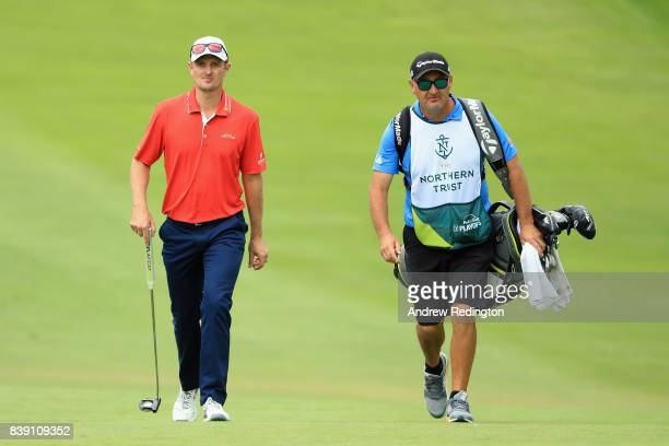 Justin Rose of England walks with caddie Mark Fulcher on the ninth hole during round two of The Northern Trust at Glen Oaks Club on August 25 2017 in...