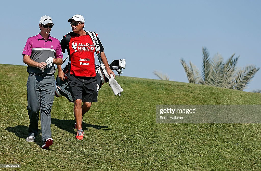 Justin Rose of England walks with his caddie Mark Fulcher on the third hole during the final round of the Abu Dhabi HSBC Golf Championship at Abu Dhabi Golf Club on January 20, 2013 in Abu Dhabi, United Arab Emirates.