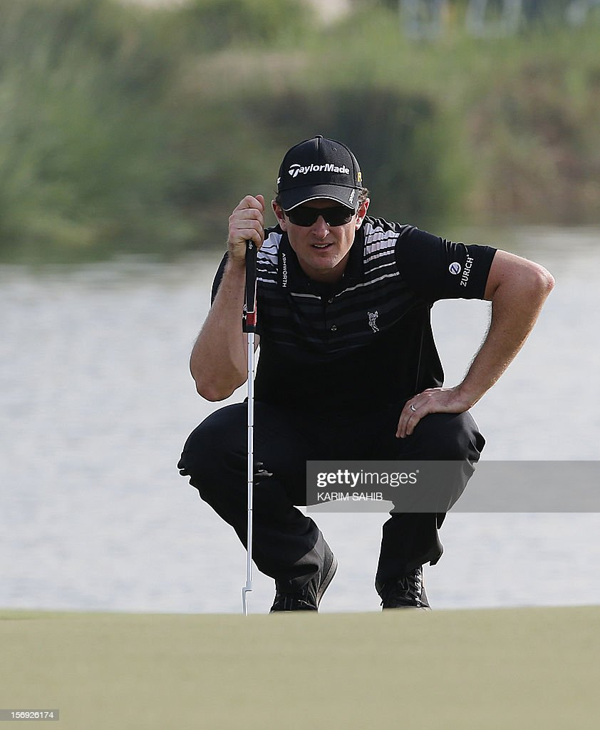 Justin Rose of England watches his ball during the 4rd round of the DP World Tour Championship in the Gulf emirate of Dubai on November 25, 2012. Rory McIlroy responded in magnificent fashion to Justin Rose's course record round of 10-under par 62 by making five birdies in his last five holes to win the DP World Tour Championship in Dubai.