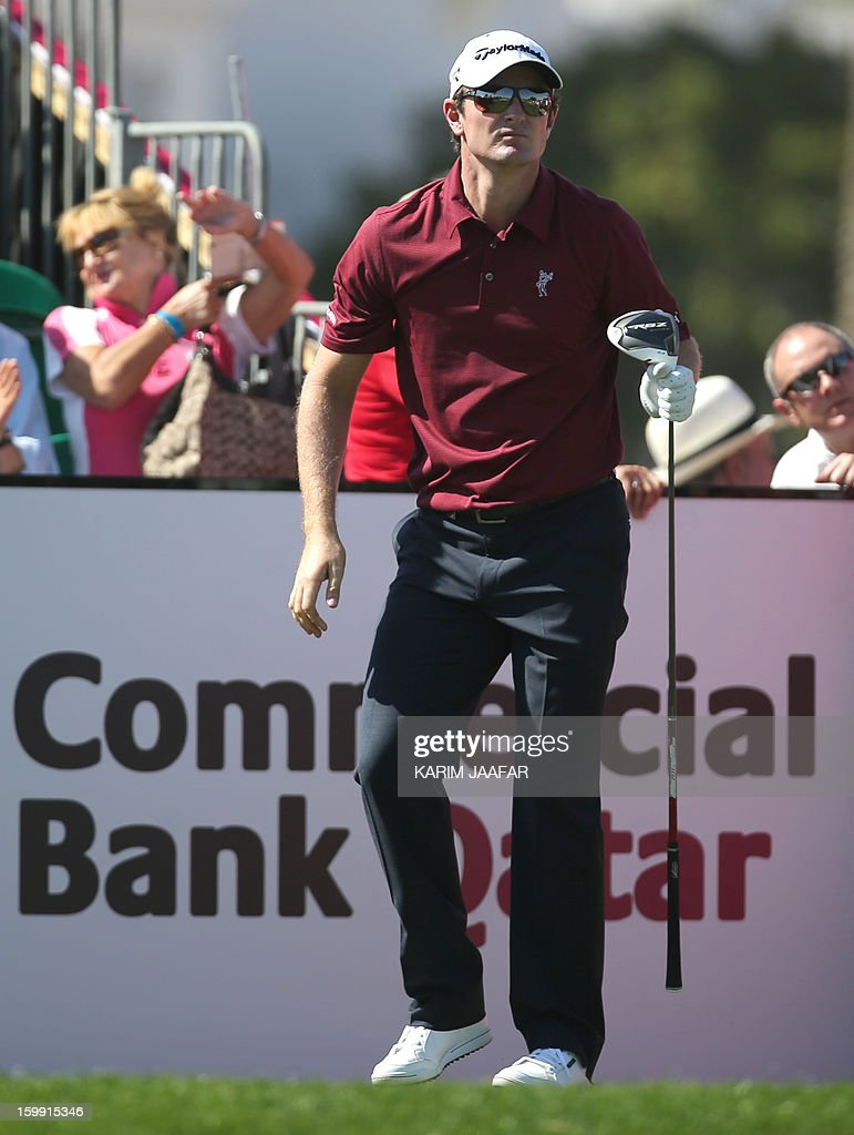 Justin Rose of England watches the ball during the first round of the Qatar Masters Golf tournament in the Qatari capital Doha, on January 23, 2013.