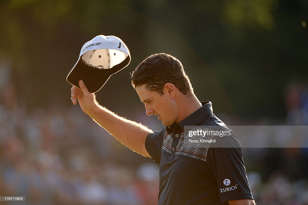 Justin Rose of England waves after putting on the 18th hole to complete the final round of the 113th US Open at Merion Golf Club on June 16 2013 in...