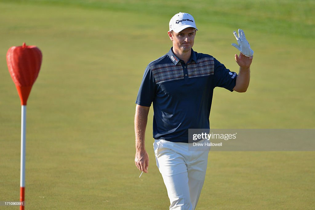 Justin Rose of England waves as he walks across the 18th green during the final round of the 113th U.S. Open at Merion Golf Club on June 16, 2013 in Ardmore, Pennsylvania.