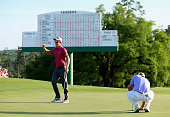Justin Rose of England waves to the gallery on the 18th green after his fiveunder par 67 during the third round of the 2015 Masters Tournament at...