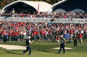 Justin Rose of Europe celebrates a birdie putt on the 18th green to defeat Phil Mickelson 1up during the Singles Matches for The 39th Ryder Cup at...