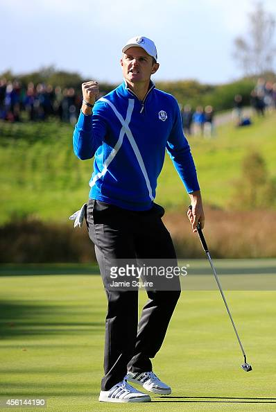 Justin Rose of Europe celebrates a putt on the 6th hole during the Afternoon Foursomes of the 2014 Ryder Cup on the PGA Centenary course at the...