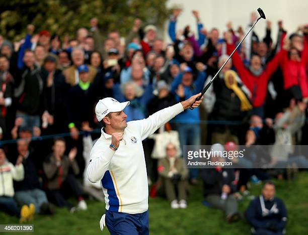 Justin Rose of Europe celebrates as he halves his match on the 18th green during the Afternoon Foursomes of the 2014 Ryder Cup on the PGA Centenary...